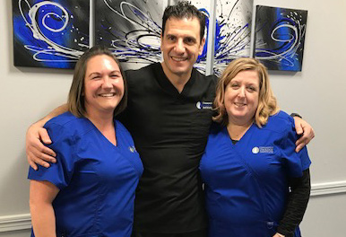 Dr Michael Scolieri and staff